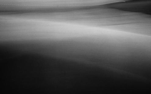 """Joan Barker, """"Walking West, Montauk, NY"""", 2001, Gelatin Silver Print."""
