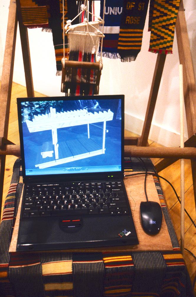 "Kofi Amponsha, ""Kente Nwen Toma"", 2000-2002, Traditional Kente Loom, Strips of woven Kente cloth, interactive virtual environment."