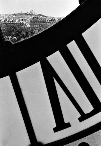 "Lewis Steven Silverman, ""D'Orsay Clock & Sacre Coeur, (Paris, France)"", 1990, gelatin silver print, 14x11."