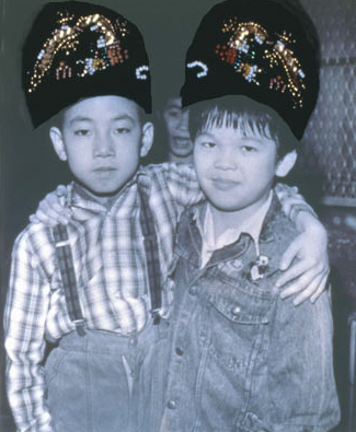 "Nina Kuo, ""Velvet Slipper Boys"", 1996, gelatin silver print with Japanese slippers and beads."
