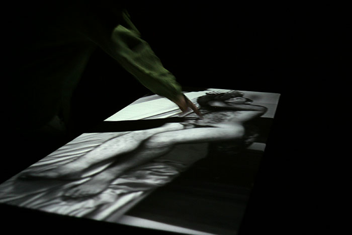 "Olivia Robinson, ""Oblivious"", 2004, video installation on touch sensitive table."