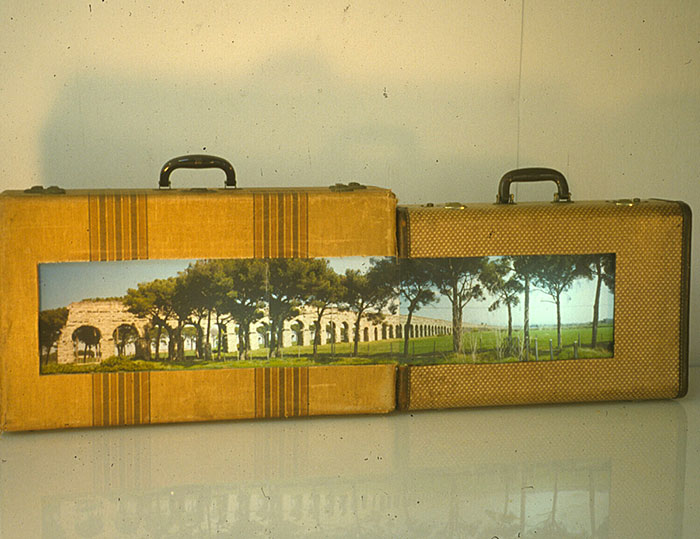 "Franc Palaia, ""Overflow, Double Suitcase"", 2006, suitcase, lightbox, transparency."