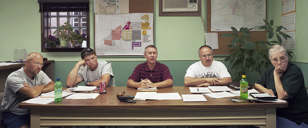 "Paul Shambroom, ""Baltic, South Dakota (population 811)"", City Council, July 8, 2003, (L to R): Larry Miller, Jason Pittmann, Mike Wendland (Mayor), Doug Burns, Willette Reichert, archival pigmented inkjet. Courtesy Julie Saul Gallery, NYC"