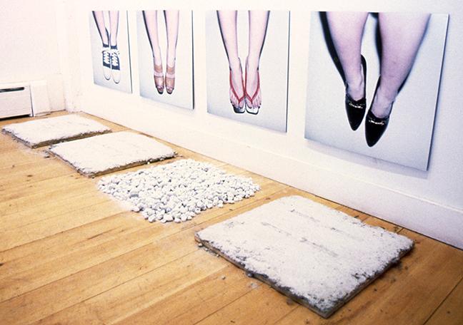 "Tomoko Negishi, ""Reminder"", 2000, instillation of four C-prints, concrete, and garden pebbles."