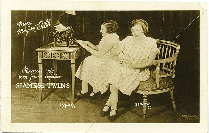 "Unknown Photographer, ""Mary Margaret Gibb - America`s only born joined together SIAMESE TWINS, Typing – Sewing"", ca. 1926, postcard photograph, 57⁄16x 3½"". Courtesy of Elizabeth J. Anderson, private collection, Austin, TX."