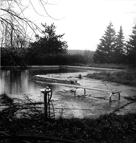 "Albert J. Winn, ""Swimming Pool, Catskills Mtns., NY"", from the series ""Summer Joins the Past: Deserted, Abandoned and Vacant Jewish Summer Camps"", 2001, gelatin silver print, 8x8"""