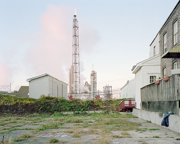 "Noah Addis, ""View of the Sunoco Marcus Hook Refinery in Marcus Hook, PA on 09/11/2011. The refinery, which has since been idled, is under consideration as a potential site for a liquefied natural-gas terminal to process and export gas from the Marcellus Shale"", pigment inkjet print, 46½x56""."