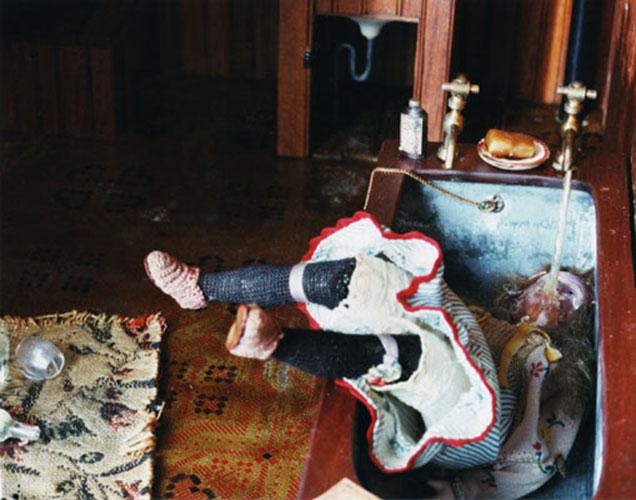 """Corinne May Botz, """"Dark Bathroom (girl in bathtub)"""", 1998-2004, C-print, courtesy Bellwether Gallery, NYC."""