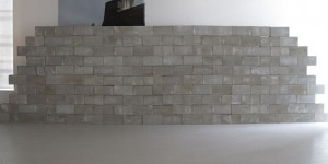 "Lourdes Correa-Carlo, ""The Backyard"", installation view, 2009, mixed media (archival inkjet print, 150 cinder blocks), 10'x25'"