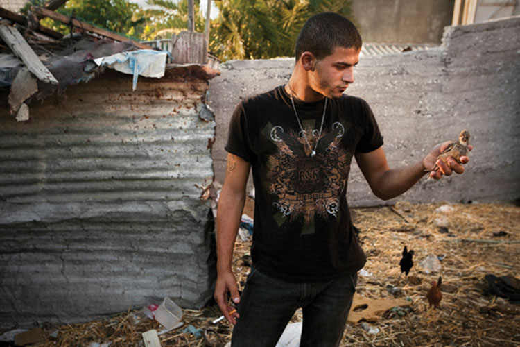 "Natan Dvir, ""Jehad Holding A Chick"", from the series ""Eighteen, 2009"", digital c-print, 24 x 36"""