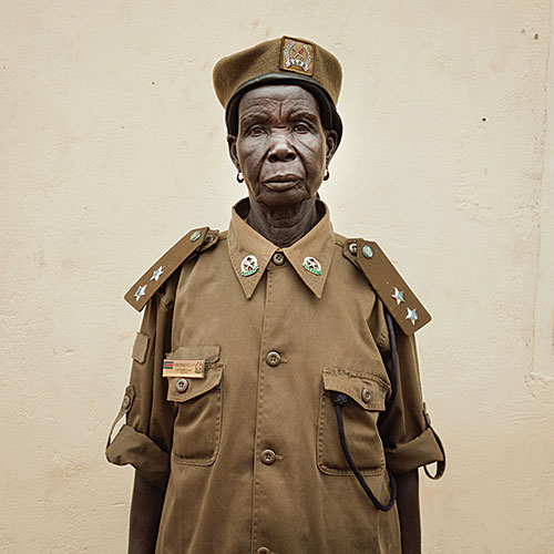 "Alinka Echeverria, ""Juba, South Sudan, June 2011. Christina Killa, the chief prison officer of Juba Women's Prison. She fought in the war for 17 years, leaving the harsh conditions of the bush only when she had children"", 2011, from the series ""Becoming South Sudan"", digital  C-print, edition of 3 + 1 AP, 30x30"""