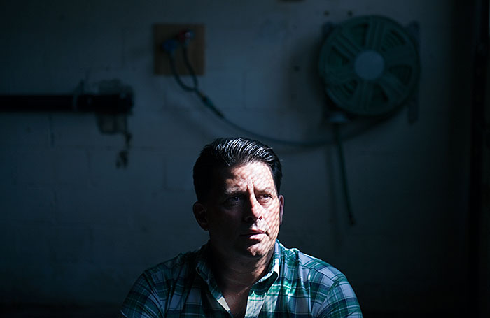 "Scott Goldsmith, ""Paul Battista, owner of Sunnyside Supply, has seen hi profit margin rise since the gas companies entered his area in Slovan, Washington County, 2010"", archival pigment print, 21⅛x28¾""."