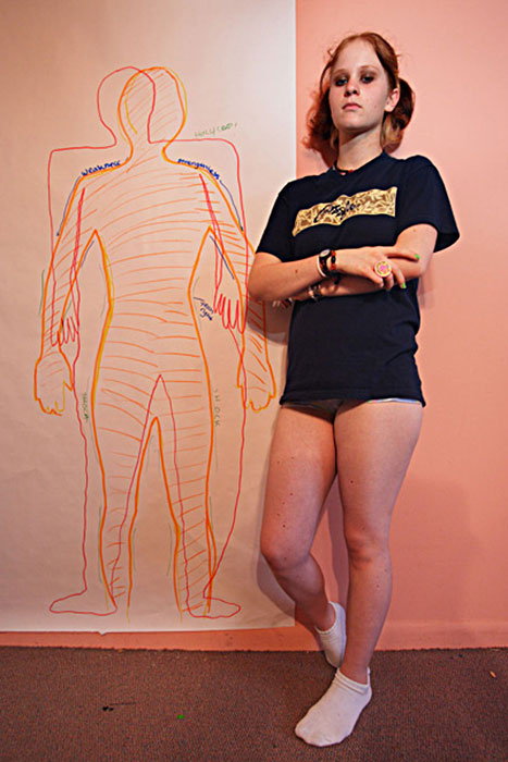 "Lauren Greenfield, ""Brittany Next to Body Tracing in Art Therapy"", Coconut Creek, Florida, 2004, from an edition of 25, silver dye bleach print mounted to Plexiglas, 40 x 27"", courtesy of Pace/MacGill Gallery, NYC."