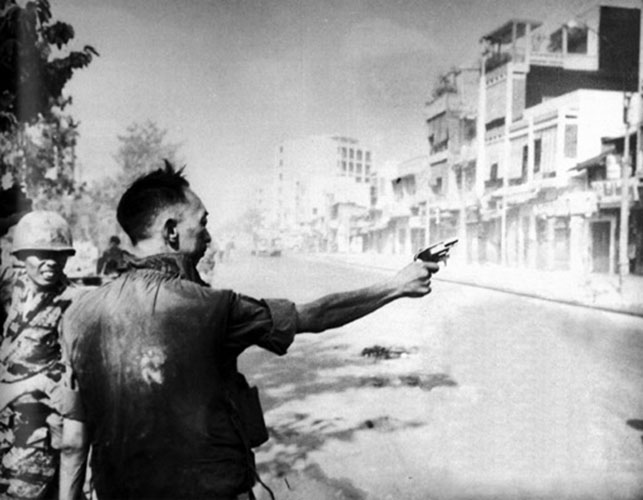 "Brian Moss, ""General Loan Executes Unidentified Viet Cong Suspect; Saigon; 1968"", 1993, silver print, 2/3"